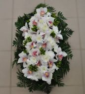 Funeral flower arrangement with orchids and chrysanthemums